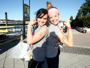 Two young girls celebrating their victory at the Run 10 Feed 10