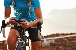 Men starting his bike app before training.
