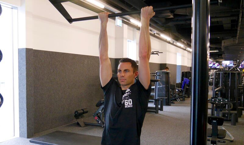 Athletic man doing Chin-ups.