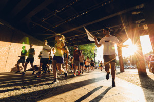 Group of people running a half marathon.