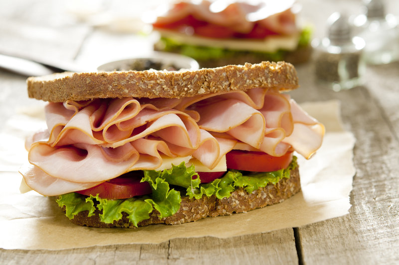 Closeup of a classic ham and cheese sandwich. Selective focus; shallow depth of field.
