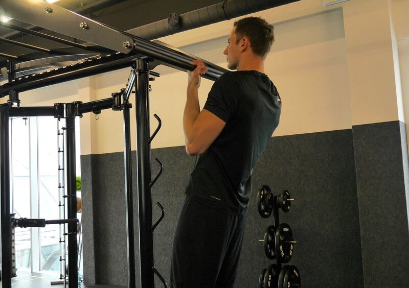 Athletic man doing Chin-ups.