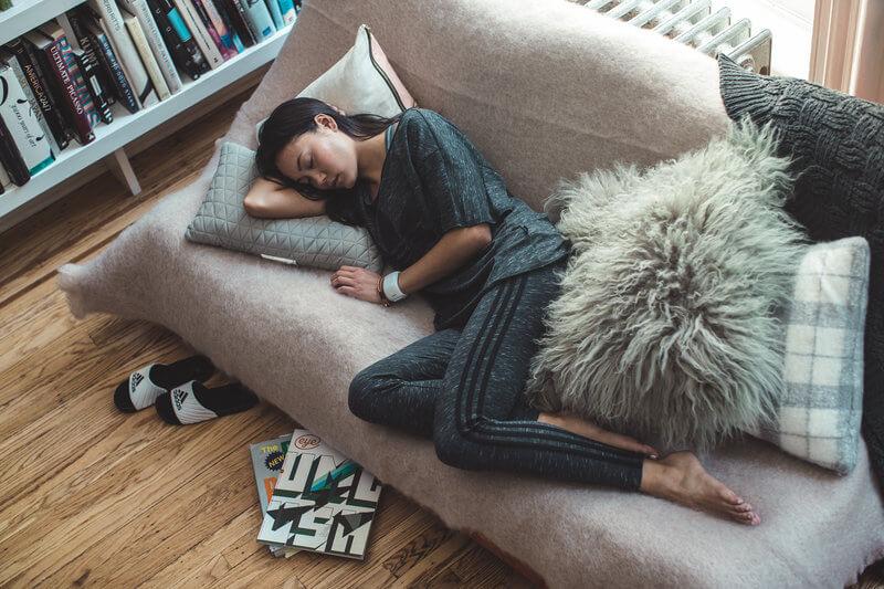Young woman sleeping on the sofa