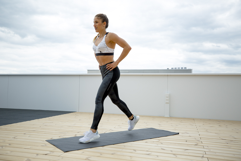 Woman is doing a jump lunge