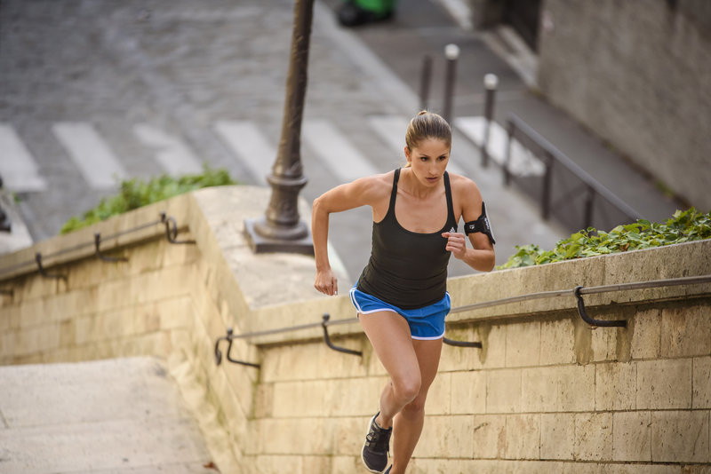 Woman doing interval runs on stairs.