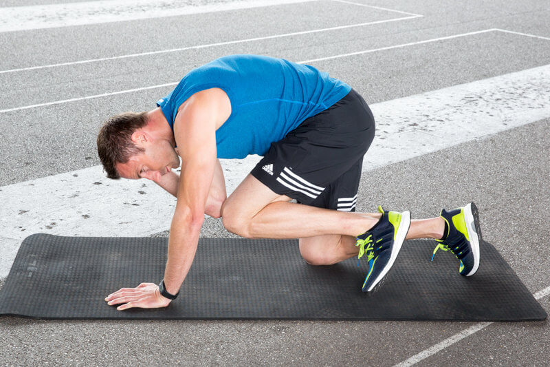 Athletic man makes a Quadrupted Limb Rotation.
