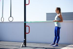 Woman doing a resistance band workout