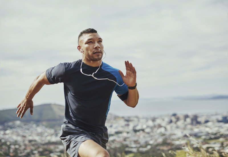 Athletic man doing sprints.