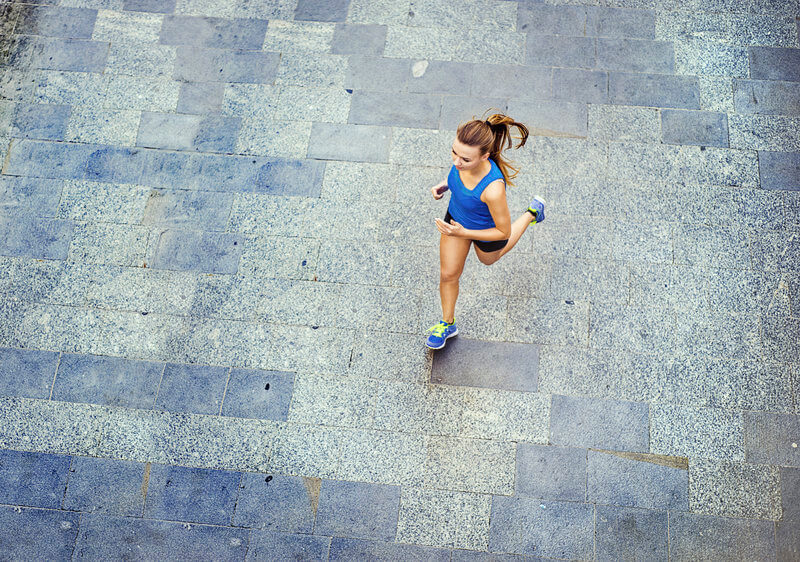 Young woman running on the street.