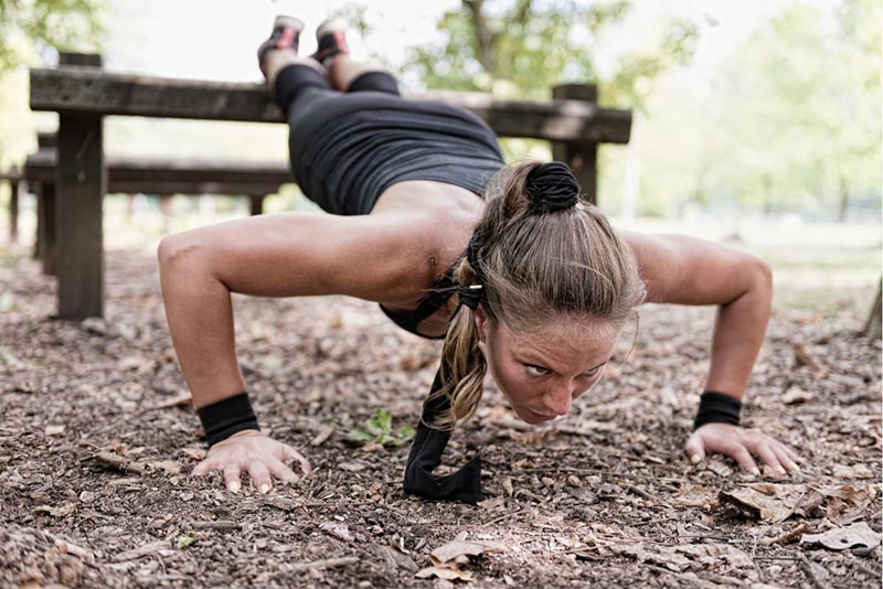 Fit girl doing a push-up.