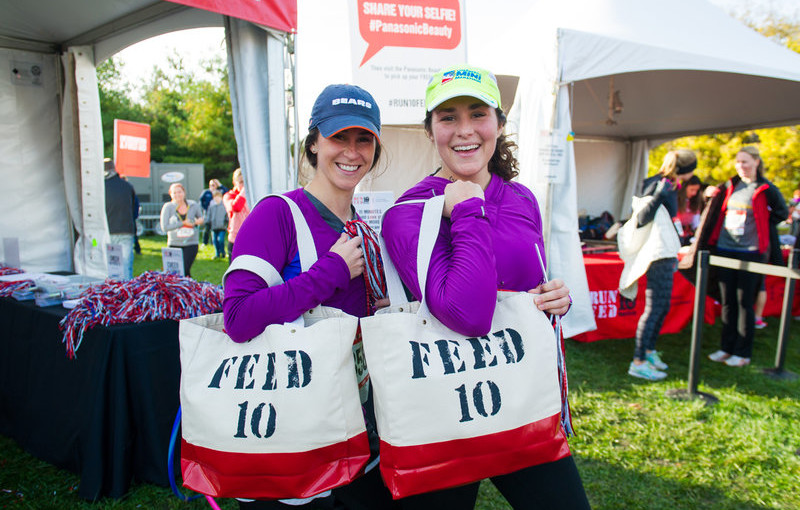 Two women at the run 10 feet 10 event.