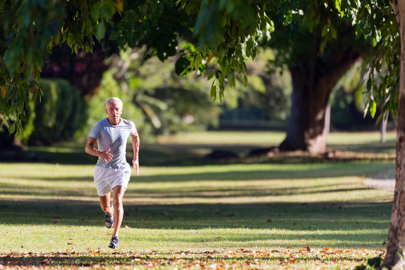 Old men running in the park.