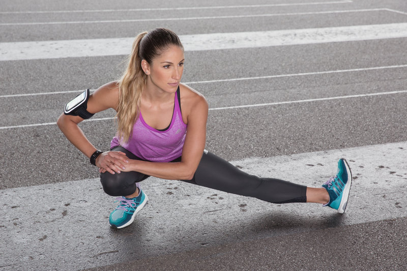 Athletic woman stretching after her running session.
