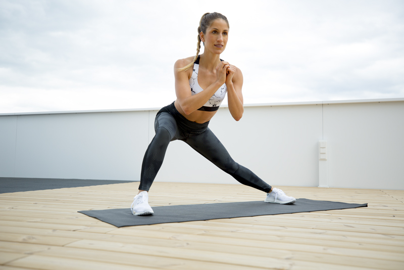 Woman is doing a side lunge