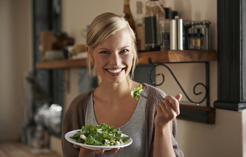 A woman eating salad