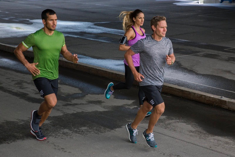 Two men and a woman running