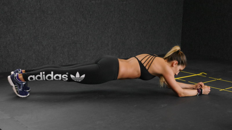 A young woman doing an extended plank