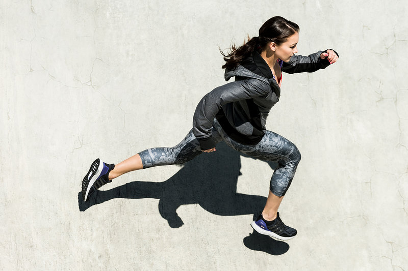 A woman who is sprinting.