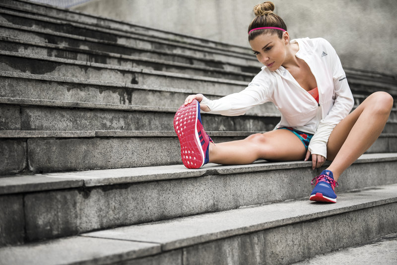 Young woman stretching before her run.