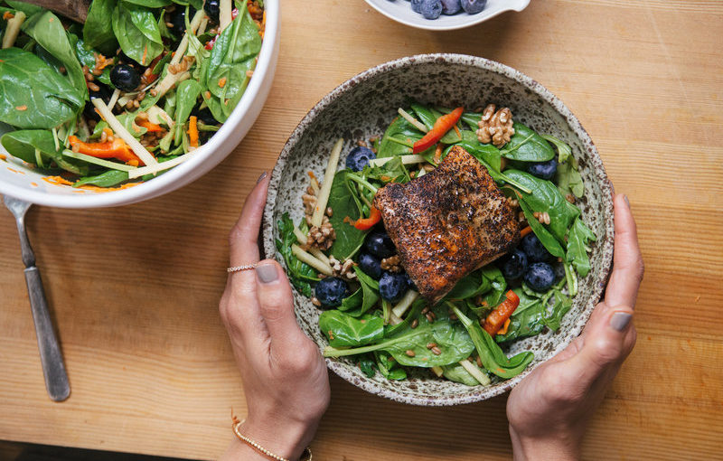 A salad bowl with salmon