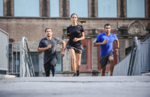 A woman and two guys running