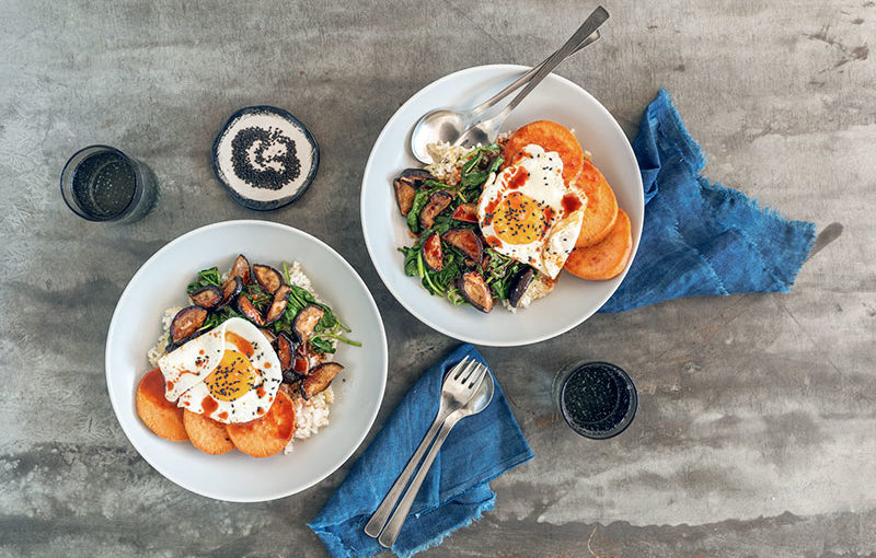 Two plates with sweet potatoes and fried eggs