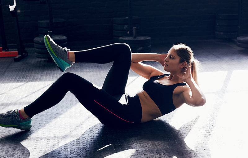 A woman doing crunches