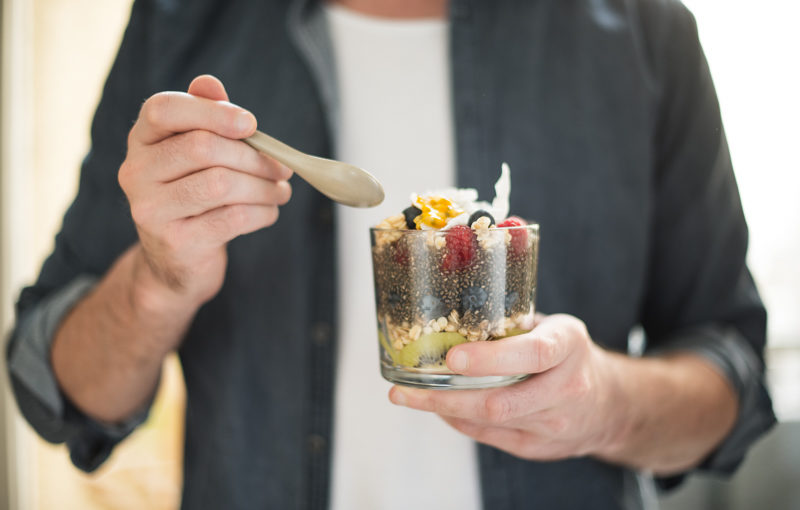 A man eating a chia pudding