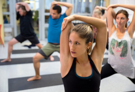 Young people doing yoga