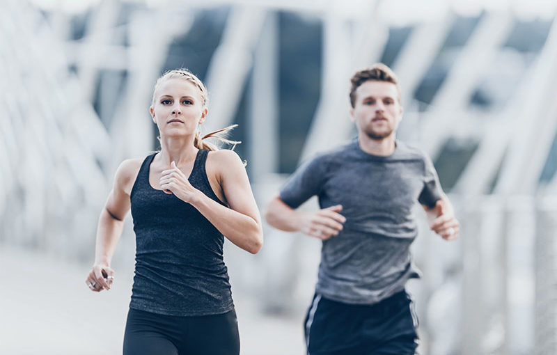 A woman and a man running