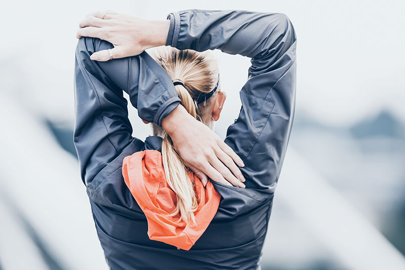 a woman doing stretching after a run