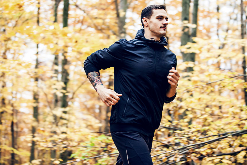 A man running in the woods