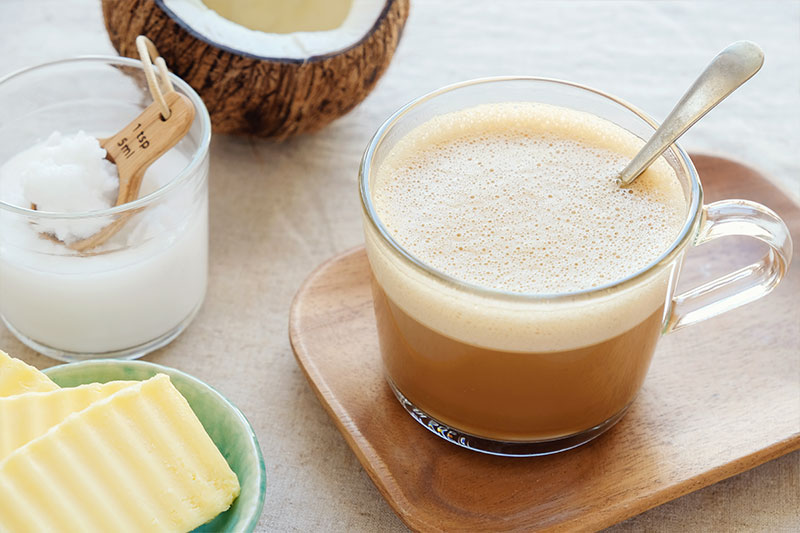 A glass of bulletproof coffee