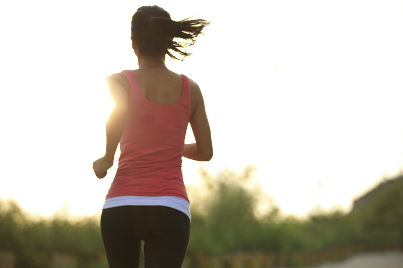 shot from behind, young woman running