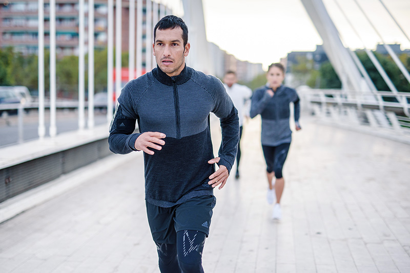 A group of people running outside