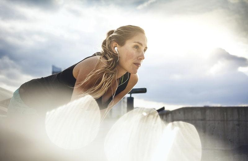 Sporty woman taking a breath