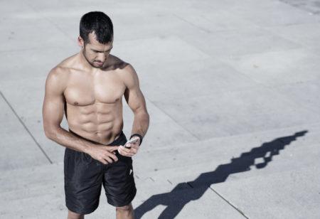 Man shirtless training outside