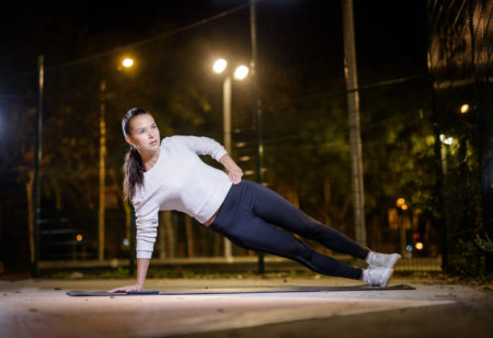 A woman doing a side plank