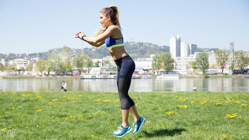 Young woman is doing Jump Lunges.