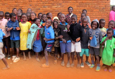 Group of kids in Malawi in front of their school.