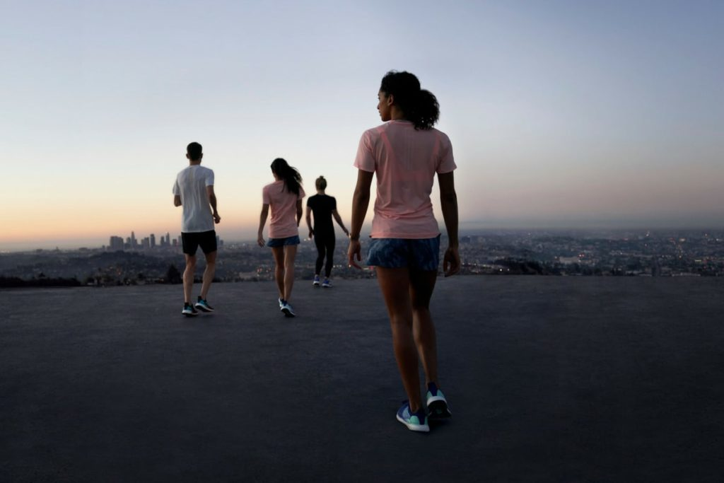 Young people meeting for a run during sunrise