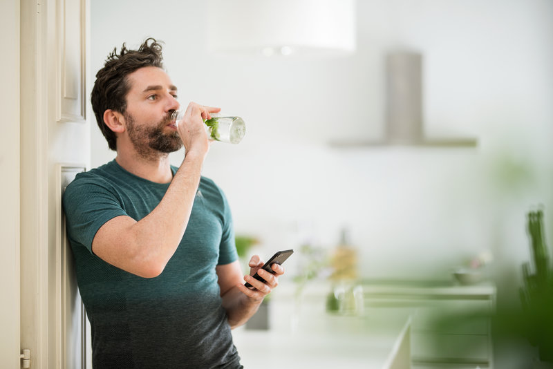 A man drinking from a water bottle