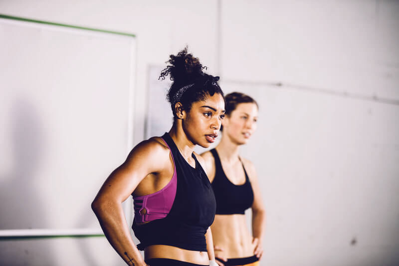Two women sweating after an intense workout