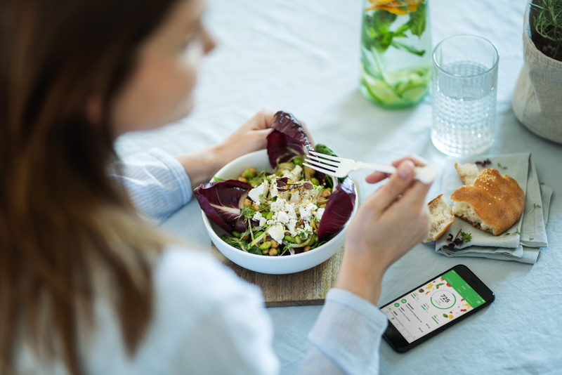 A woman eating a salad