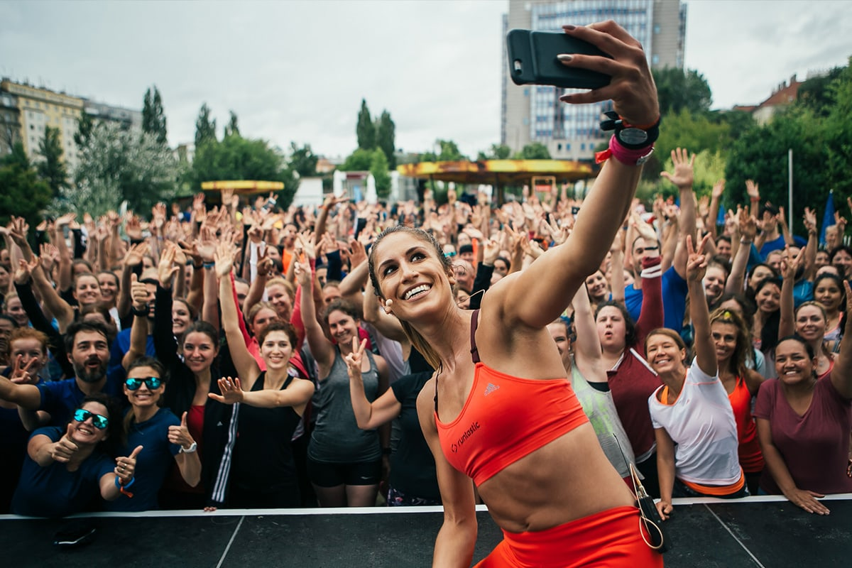 Woman taking a selfie with a workout group
