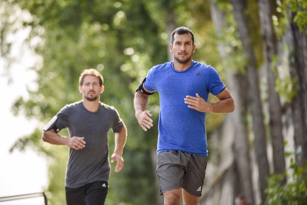 Two men running in different speeds