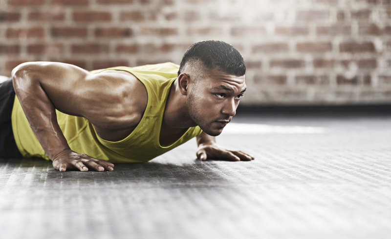 Athletic man doing a push up.