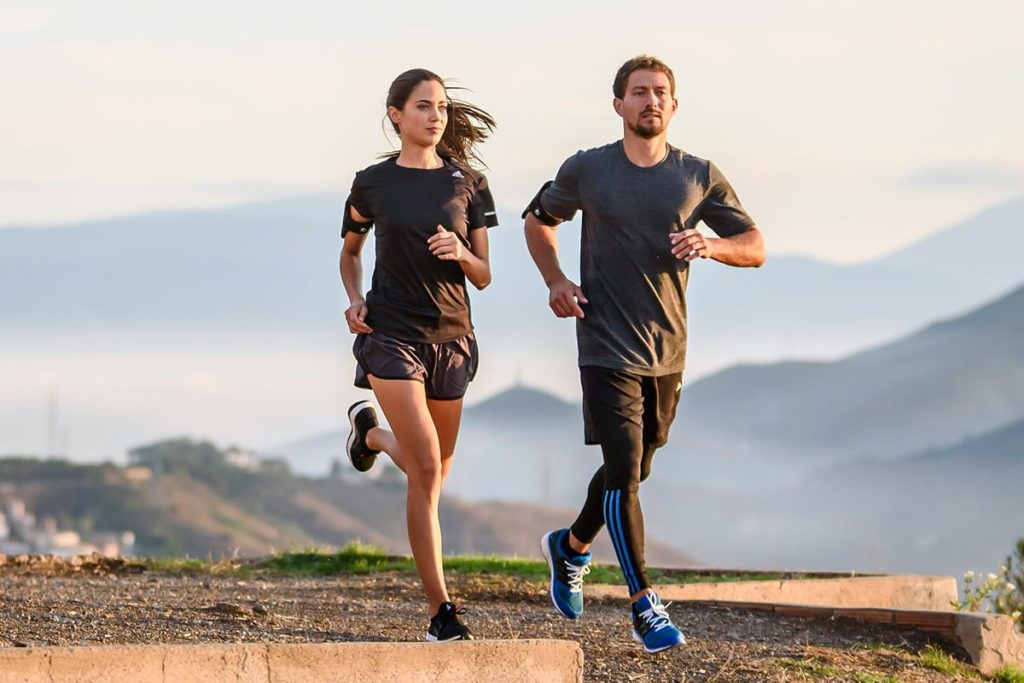 Two people running