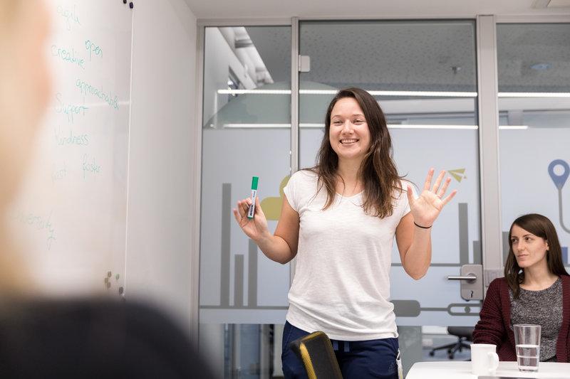 A woman speaking in an office