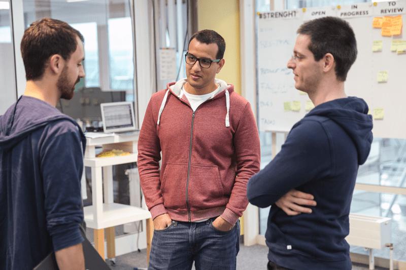 Three men talking in the office